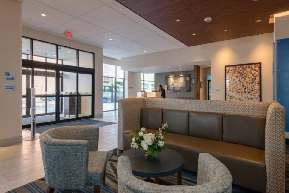 Photo -  The lobby of the 116-room Holiday Inn Express & Suites in Tulsa. [PROVIDED BY THE ROSS GROUP]