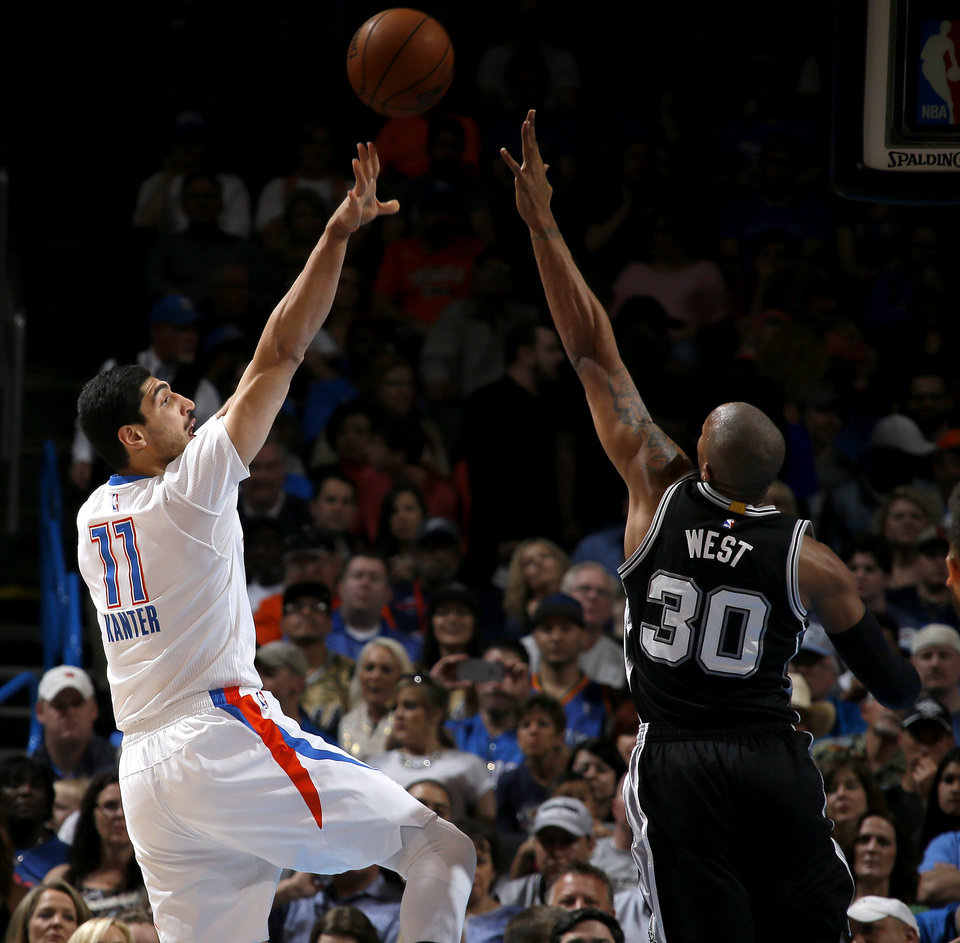 Photo - Oklahoma City's Enes Kanter (11) shoots over San Antonio's David West (30) during an NBA basketball game between the Oklahoma City Thunder and the San Antonio Spurs at Chesapeake Energy Arena in Oklahoma City, Saturday, March 26, 2016. Photo by Bryan Terry, The Oklahoman