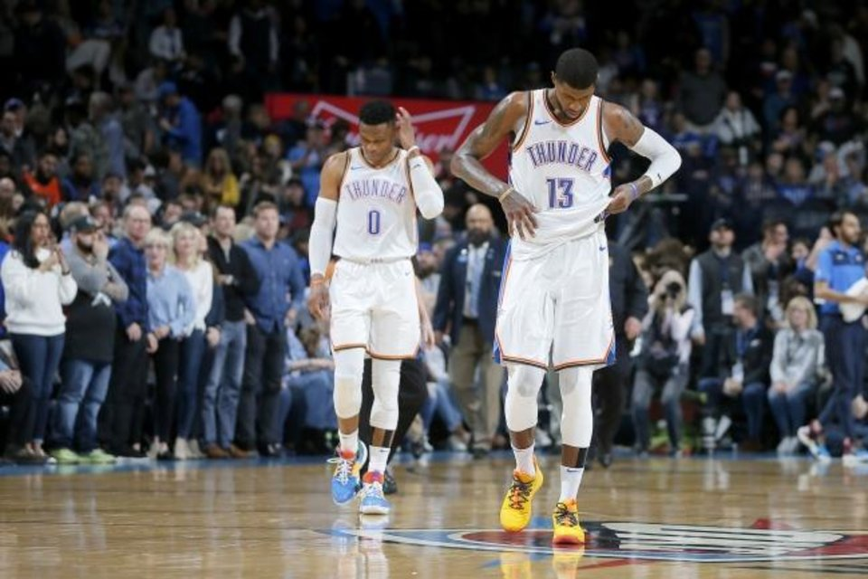 Photo -  Paul George, right, and Russell Westbrook walk off the court after a February loss to Sacramento at Chesapeake Energy Arnea. George was traded last week to the Los Angeles Clippers, and the Thunder is reportedly taking trade offers for Westbrook. [Bryan Terry/THE OKLAHOMAN]