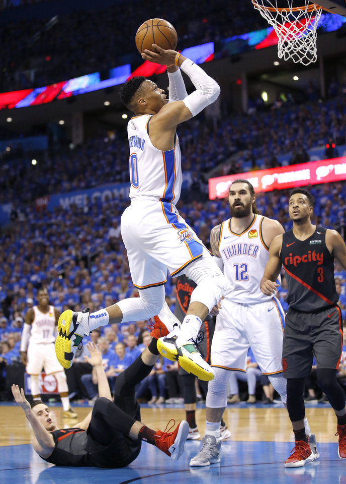 Photo - Oklahoma City's Russell Westbrook (0) goes up for a basket during Game 4 in the first round of the NBA playoffs between the Portland Trail Blazers and the Oklahoma City Thunder at Chesapeake Energy Arena in Oklahoma City, Sunday, April 21, 2019.  Photo by Sarah Phipps, The Oklahoman