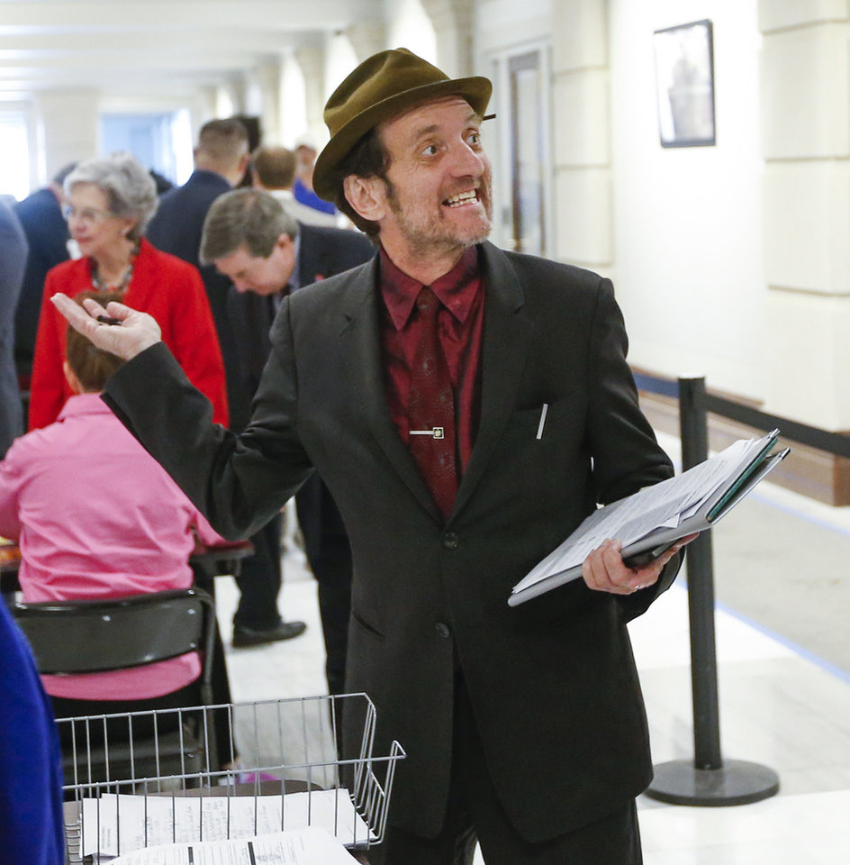 Photo - Musician and songwriter Tyson Meade files to run for District 5 in the U.S. House of Representatives as a Democrat during candidate filing at the state Capitol in Oklahoma City, Thursday, April 12, 2018. Photo by Nate Billings, The Oklahoman