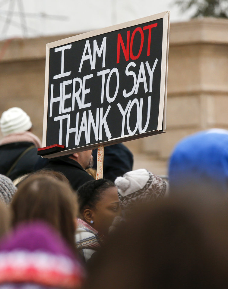 "Photo - A sign referencing Gov. Fallin's statement that she hoped teachers would say 'thank you"" today during a rally and walkout by Oklahoma teachers at the state Capitol in Oklahoma City, Monday, April 2, 2018. Photo by Nate Billings, The Oklahoman"