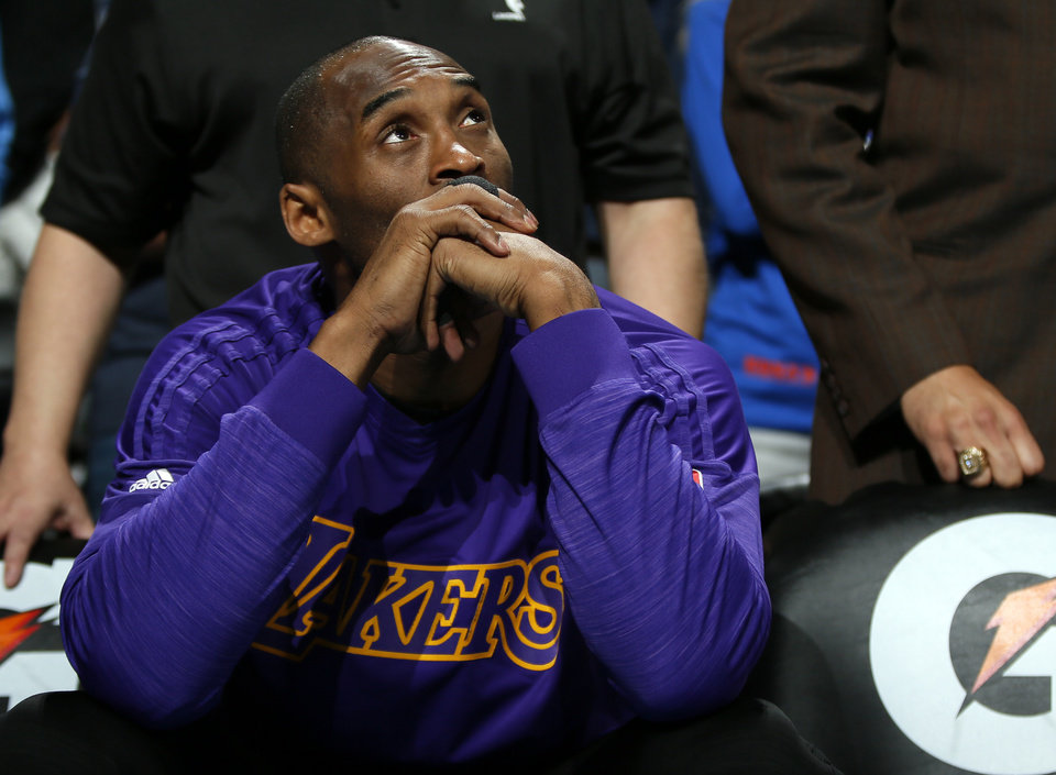 Photo - Los Angeles' Kobe Bryant (24) watches a special video for him before being introduced at an NBA basketball game between the Oklahoma City Thunder and the Los Angeles Lakers at Chesapeake Energy Arena in Oklahoma City, Monday, April 11, 2016. [Nate Billings/ The Oklahoman]