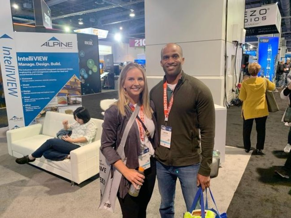 Photo -  Brandi and Kenyon Woods, owners of Authentic Custom Homes, are pictured at the International Builders Show last month in Las Vegas. [PHOTO PROVIDED]