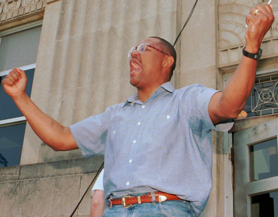 Photo -  Thomas Webb III exits the Cleveland County courthouse a free man May 24, 1996. [Photo by Paul Hellstern, The Oklahoman]