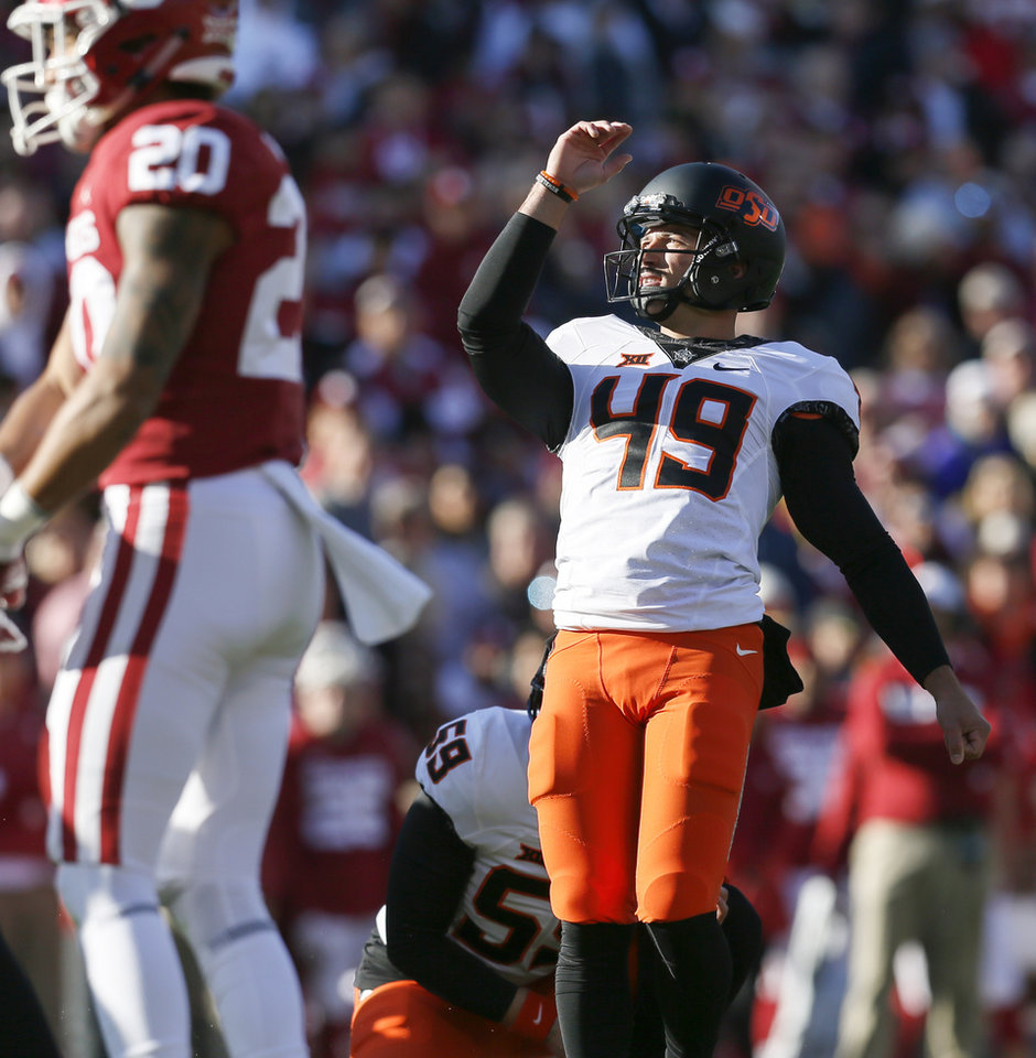Photo - Oklahoma State's Matt Ammendola (49) watches as his field goal attempt misses in the first quarter of a Bedlam college football game between the University of Oklahoma Sooners (OU) and the Oklahoma State University Cowboys (OSU) at Gaylord Family-Oklahoma Memorial Stadium in Norman, Okla., Nov. 10, 2018. Photo by Nate Billings, The Oklahoman