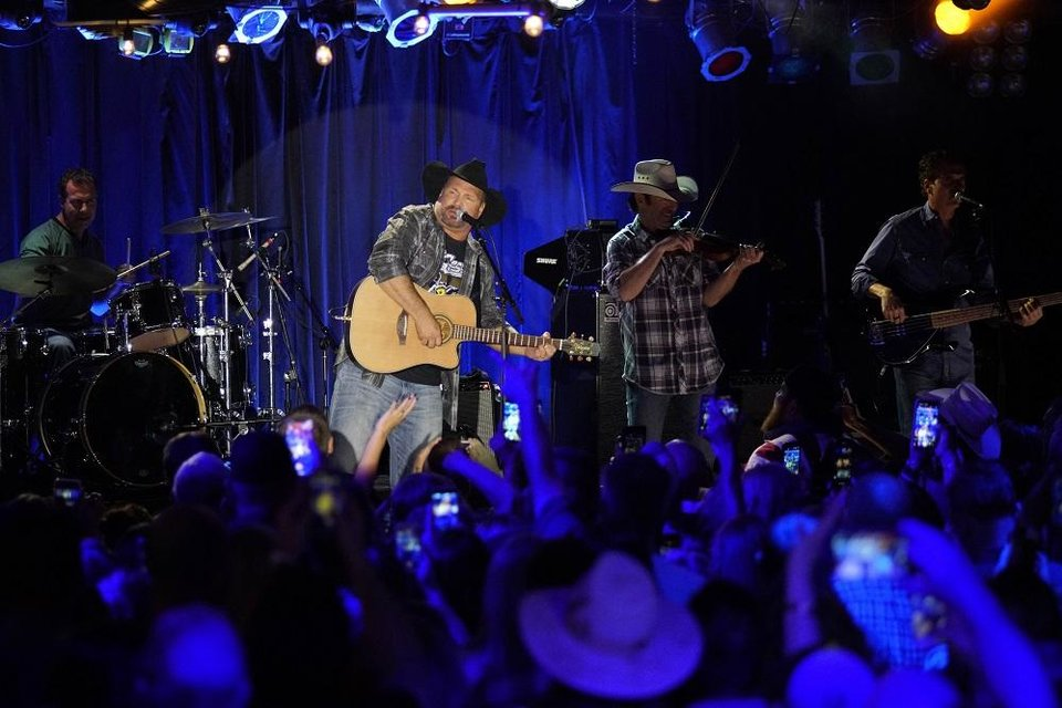 Photo - Garth Brooks performs at Joe's in Chicago, Monday, July 15, 2019, on the first stop of his Dive Bar tour. Garth has partnered with Seagram's 7 Crown to secure 700,000 pledges to #JoinThePact, a pledge to never drive impaired. (Photo by Rob Grabowski/Invision/AP)