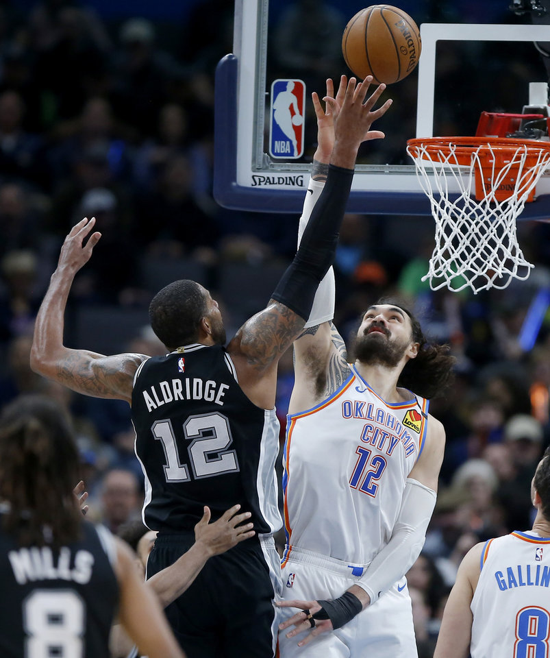 Photo - San Antonio's LaMarcus Aldridge (12) shoots a basket over Oklahoma City's Steven Adams (12) during an NBA basketball game between the Oklahoma City Thunder and the San Antonio Spurs at Chesapeake Energy Arena in Oklahoma City, Tuesday, Feb. 11, 2020. [Bryan Terry/The Oklahoman]