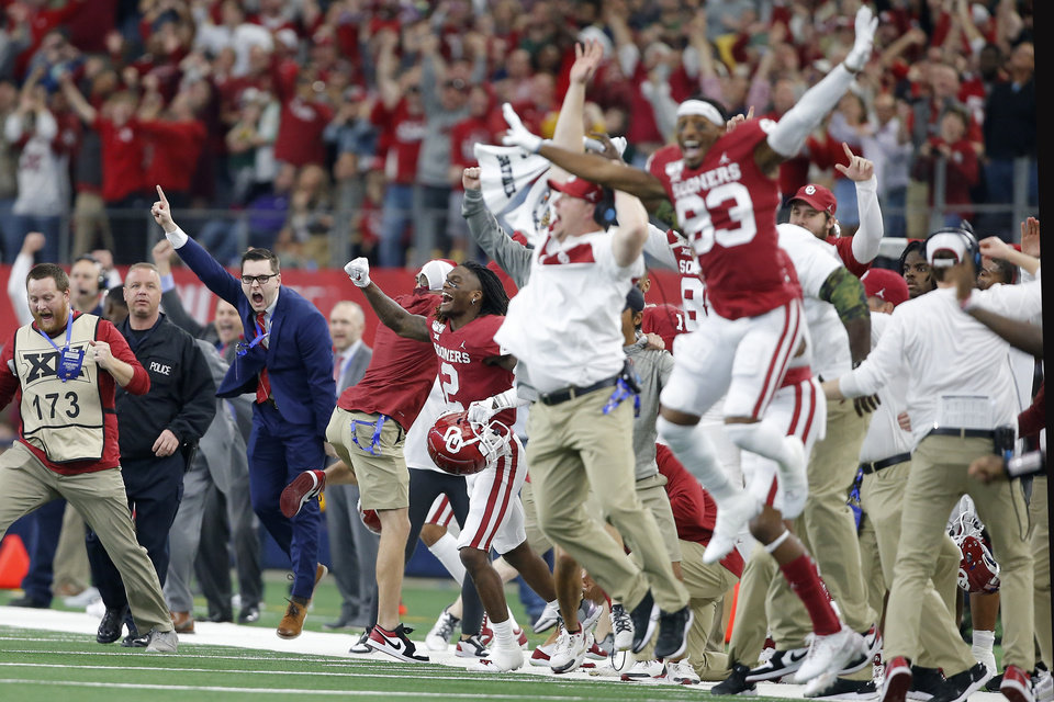 Photo - Oklahoma's CeeDee Lamb (2) and other Oklahoma players celebrate at the end of the Big 12 Championship Game between the University of Oklahoma Sooners (OU) and the Baylor University Bears at AT&T Stadium in Arlington, Texas, Saturday, Dec. 7, 2019. Oklahoma won 30-23. [Bryan Terry/The Oklahoman]