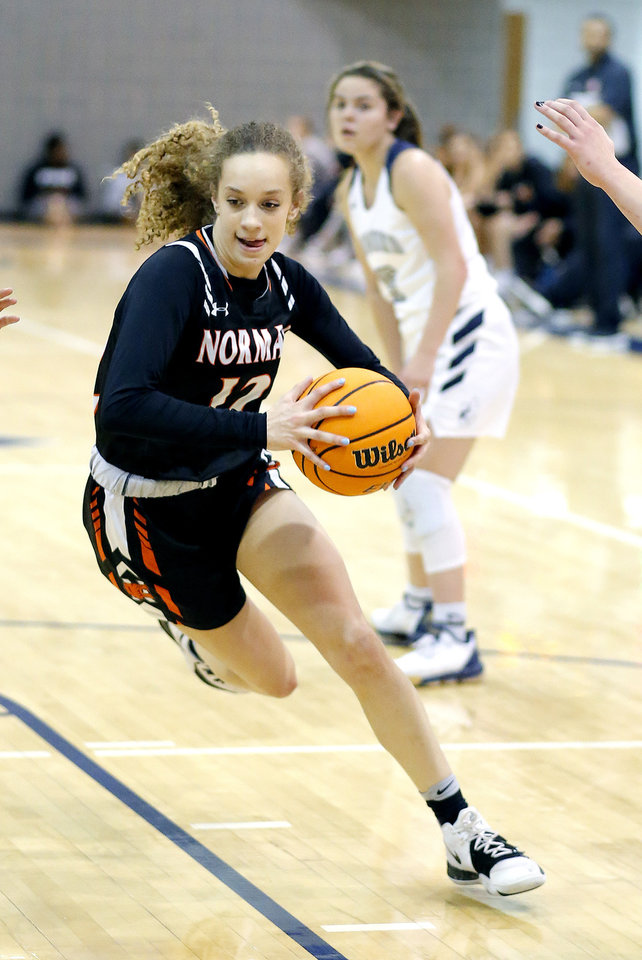Photo - Norman's Mikalya Parks drives to the basket during the high school girls game between Edmond North and Norman at Edmon North in Edmond, Okla., Friday, Jan. 17, 2020.  [Sarah Phipps/The Oklahoman]