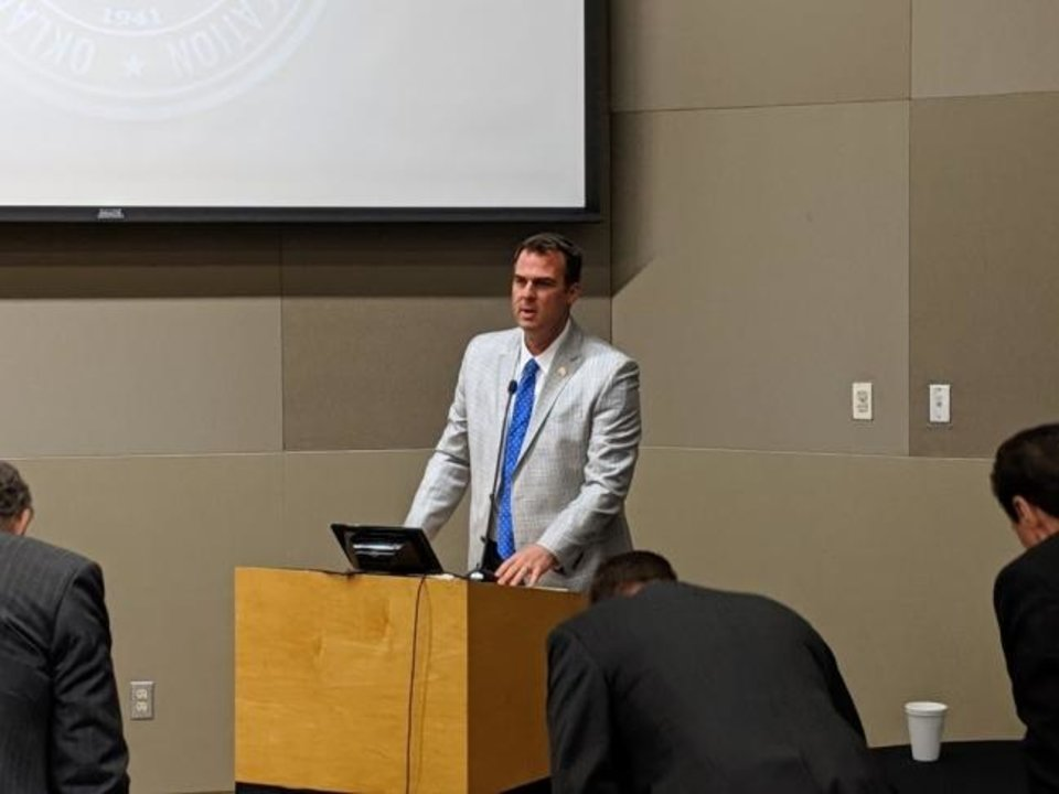 Photo -  Gov. Kevin Stitt speaks to the Oklahoma State Regents for Higher Education on Wednesday. [Adam Kemp/The Oklahoman]