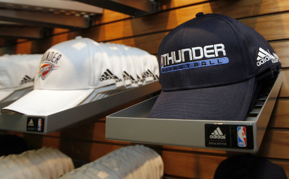 Photo - Hats for sale in the team store after the unveiling of the Oklahoma City Thunder NBA team name at Leadership Square in downtown Oklahoma City, Wednesday, September 3, 2008. NATE BILLINGS, THE OKLAHOMAN