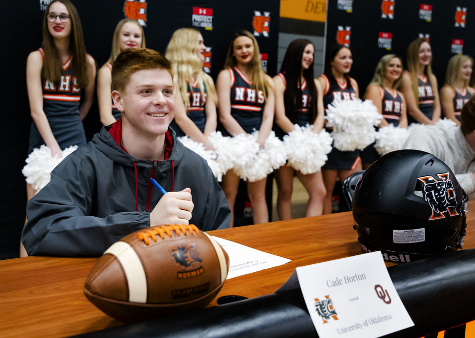 Photo - University of Oklahoma signee Cade Horton celebrates signing his letter of intent during a national signing day ceremony for football at Norman High School in Norman Okla. on Wednesday, Dec. 18, 2019.   [Chris Landsberger/The Oklahoman]