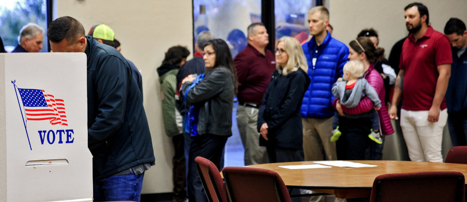 Photo - Voters line up to cast their ballots at the International Pentecostal Assembly in Yukon, Okla. on Tuesday, Nov. 6, 2018. Photo by Chris Landsberger, The Oklahoman