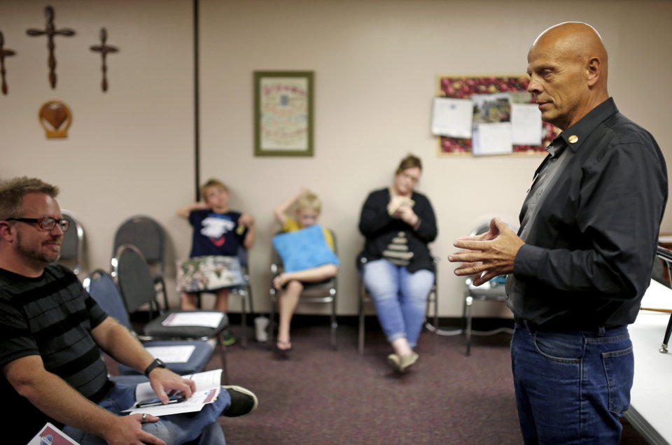 Photo -  Doug Weeks talks to participants at a Moore Toastmasters meeting. [PHOTO BY BRYAN TERRY, THE OKLAHOMAN]