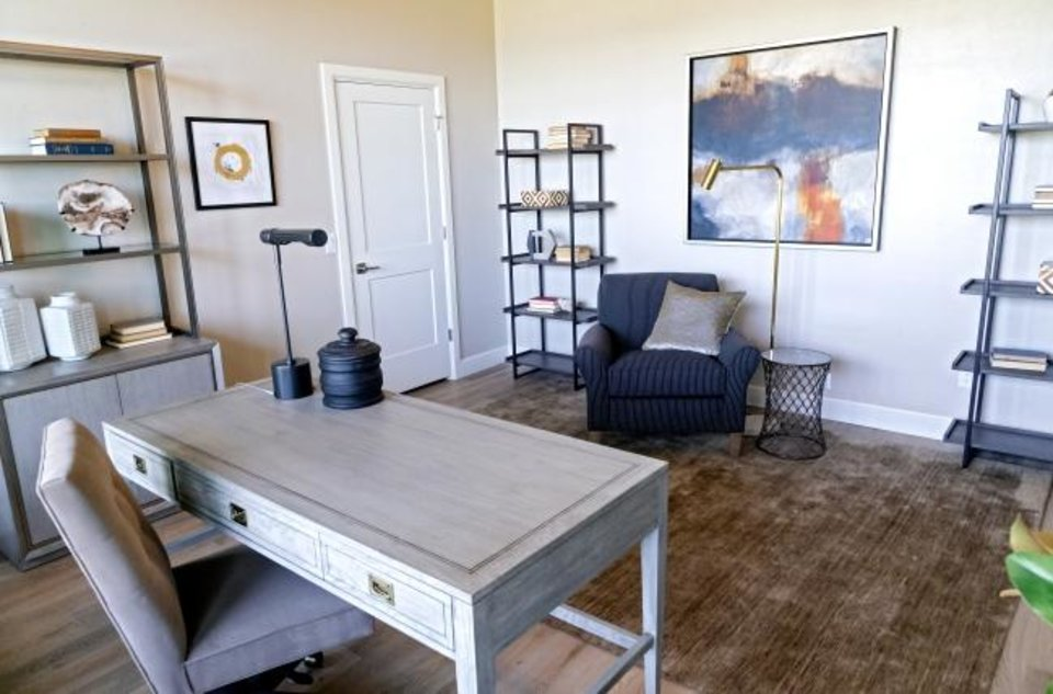Photo -  Office space in the home at 2432 SW 127, built by Craig Smith Building Inc., one of the homes open during the Gallery of Homes at Rivendell from 1 to 8 p.m./ daily through July 12. The fireplace and living room at Gallery of Homes at Rivendell.  [CHRIS LANDSBERGER/THE OKLAHOMAN]