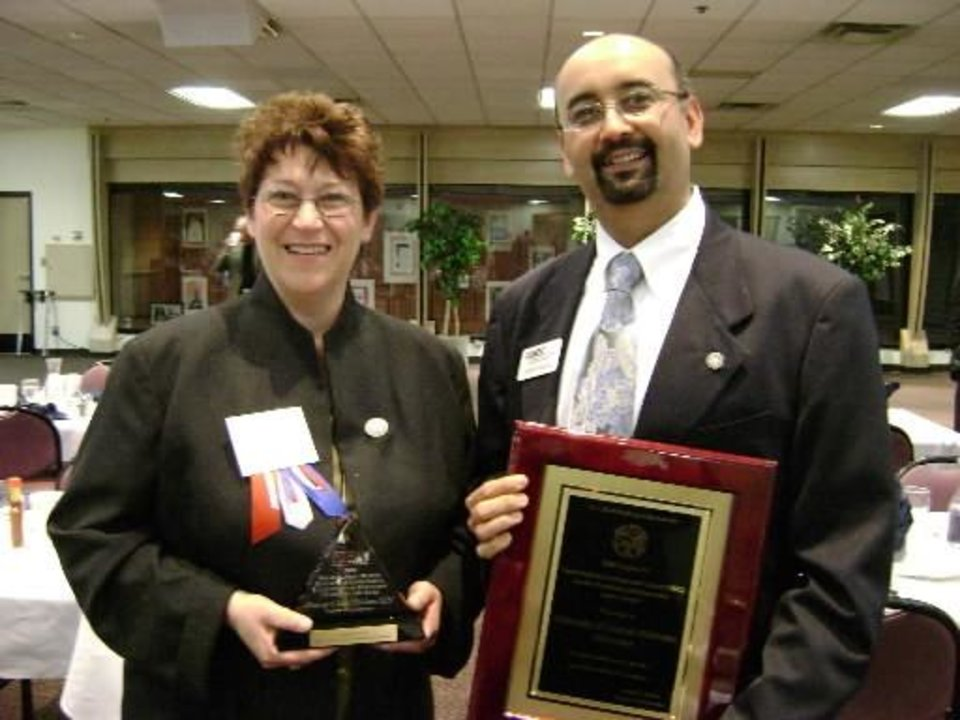 Photo -  Susan  Urbach and Carlos Amaya with the University of Central Oklahoma's Small Business Development Center receive the 2008 Small Business Development Center Service Excellence and Innovation Center of the Year award in March during the Small Business Award Luncheon at Rose State College. PHOTO PROVIDED BY UNIVERSITY OF CENTRAL OKLAHOMA SMALL BUSINESS DEVELOPMENT CENTER