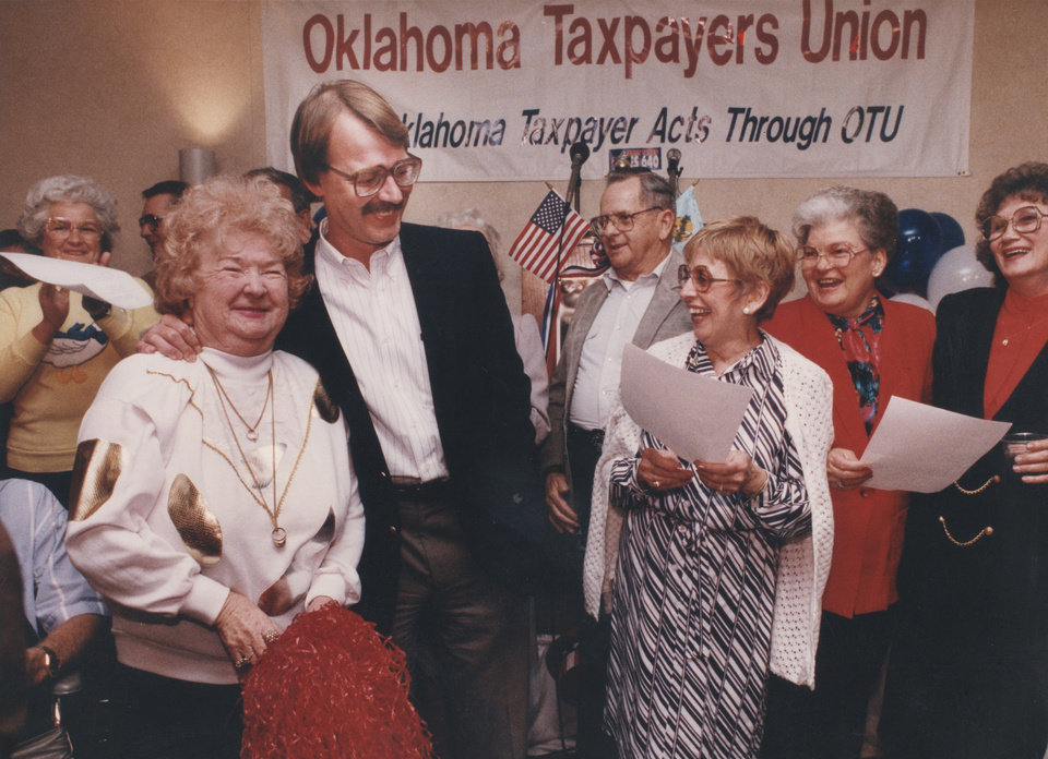 Photo - 20th ANNIVERSARY OF HB-1017.  Dan Brown, director of the Oklahoma Taxpayers Union, enjoys victory Tuesday night with Olive McIntyre, left. McIntyre, of Seminole County, helped organize support for State Question 640, the tax limitation initiative in southeastern Oklahoma. Photo taken March 10, 1992.  by Jim Beckel, The Oklahoman