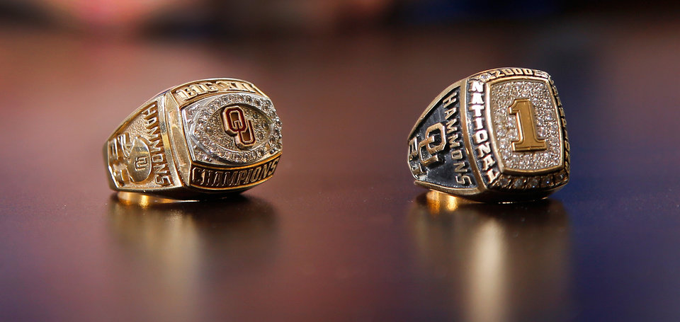 Photo -  Hammons keeps his Big 12 and national championship rings in his desk drawer to wear the week the University of Oklahoma plays Texas and on other big game weeks. [PHOTO BY JIM BECKEL, THE OKLAHOMAN]