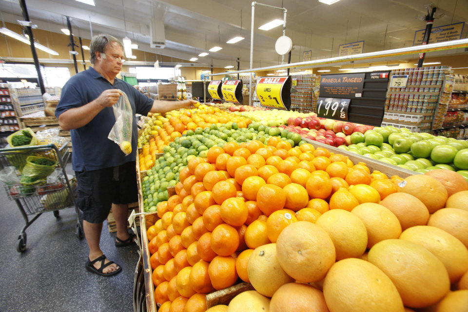 Photo -  Richard Magann picks out fresh fruits at the new Sunflower Farmers Market grocery store in Oklahoma City, OK, Tuesday, Aug. 30, 2011. By Paul Hellstern, The Oklahoman