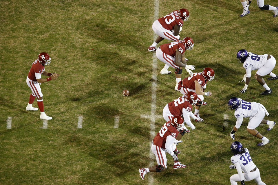 Photo - Oklahoma's Jalen Hurts (1) starts a play during an NCAA football game between the University of Oklahoma Sooners (OU) and the TCU Horned Frogs at Gaylord Family-Oklahoma Memorial Stadium in Norman, Okla., Saturday, Nov. 23, 2019. Oklahoma won 28-24. [Bryan Terry/The Oklahoman]