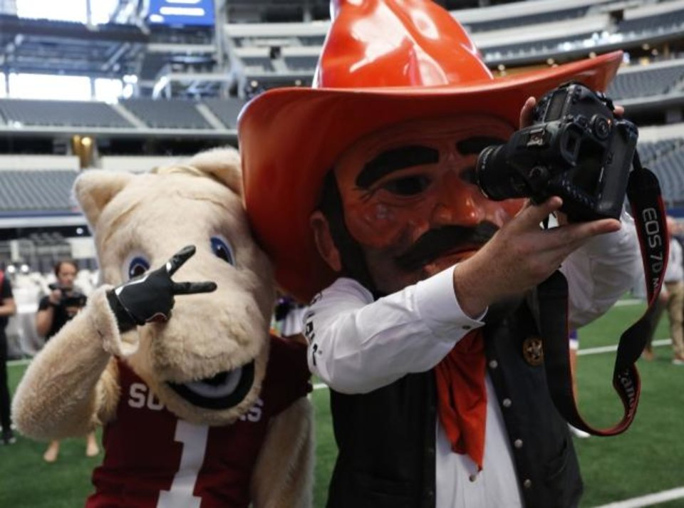 Photo -  Boomer, left, and Pistol Pete shoot a selfie during last year's Big 12 media day at AT&T Stadium in Arlington, Texas. [AP Photo/David Kent]