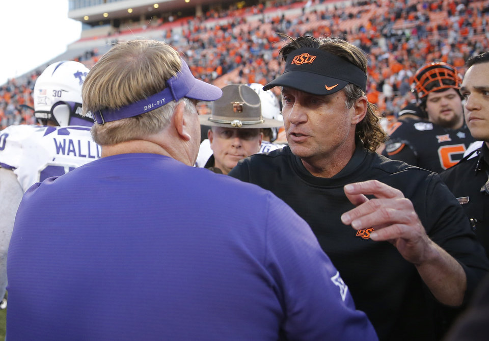 Photo - Oklahoma State head coach Mike Gundy greats TCU head coach Gary Patterson following the college football game between the Oklahoma State University Cowboys and the TCU Horned Frogs at Boone Pickens Stadium in Stillwater, Okla.,  Saturday, Nov. 2, 2019. OSU won 34-27. [Sarah Phipps/The Oklahoman]