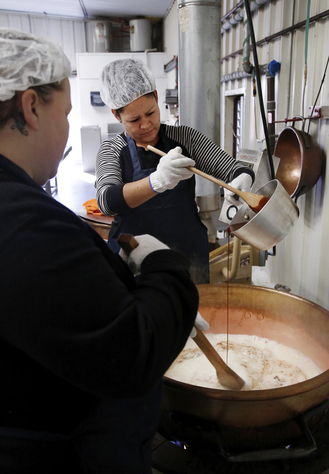 Photo -  Workers prepare a batch of Aunt Bill's Brown Candy, a customer favorite at Woody Candy Co., 900 block of NW 70. Photo by Jim Beckel, The Oklahoman   Jim Beckel -  THE OKLAHOMAN