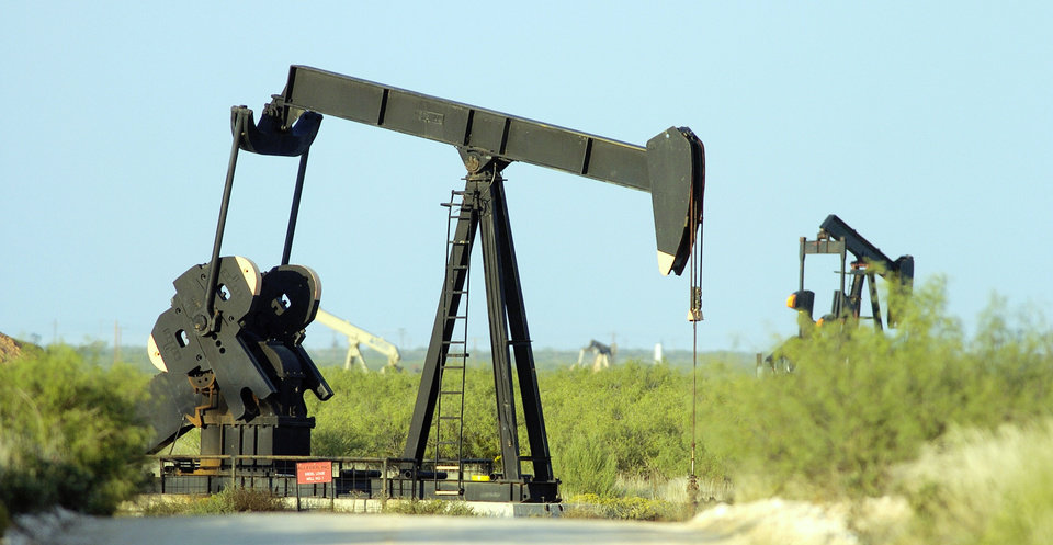 Photo -  Pumpjacks help produce oil southwest of Andrews. [The Oklahoman Archives]