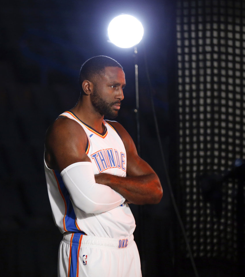 Photo - Patrick Patterson poses during a photo shoot at media day for the Oklahoma City Thunder at Chesapeake Energy Arena in Oklahoma City, Monday, Sept. 24, 2018. Photo by Nate Billings, The Oklahoman
