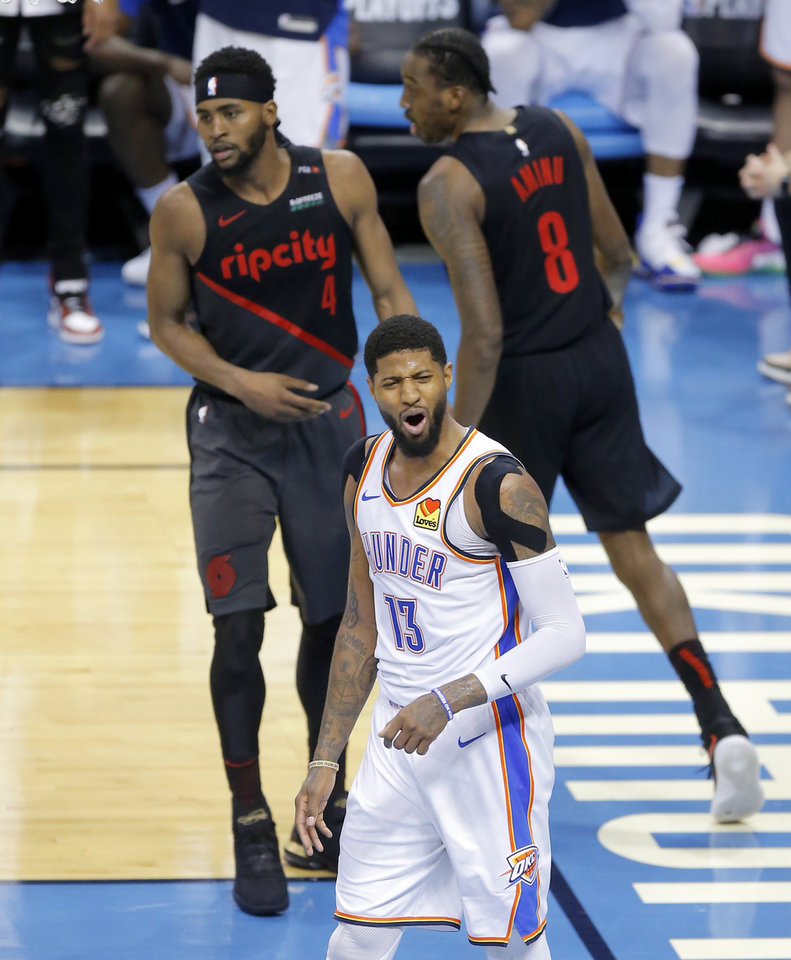 Photo - Oklahoma City's Paul George (13) reacts during Game 4 in the first round of the NBA playoffs between the Portland Trail Blazers and the Oklahoma City Thunder at Chesapeake Energy Arena in Oklahoma City, Sunday, April 21, 2019. Portland won 11-98.  Photo by Bryan Terry, The Oklahoman