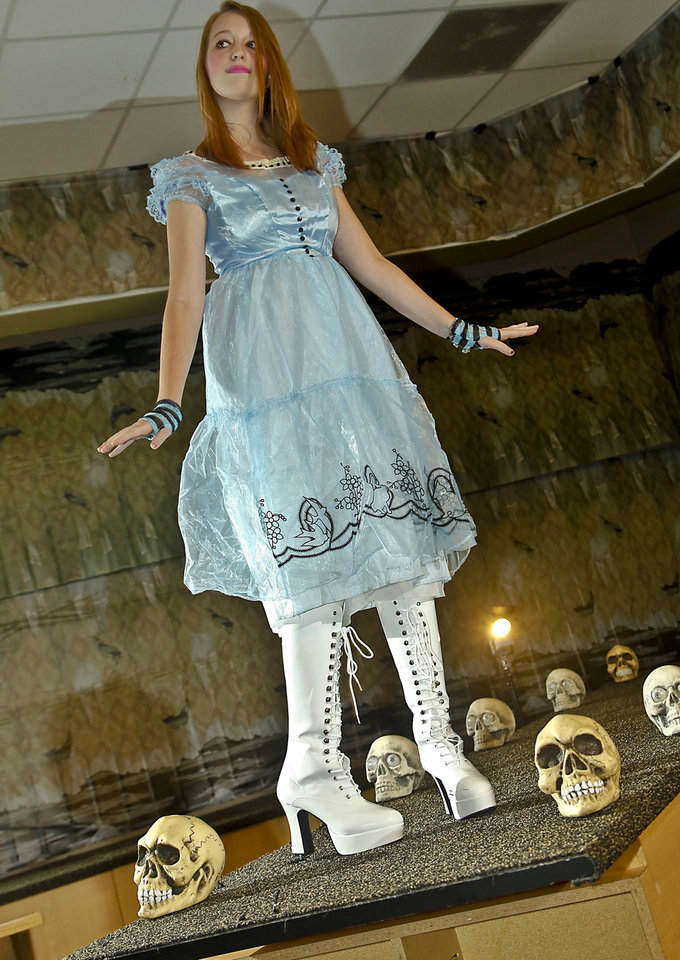 Photo - Mia models an Alice in Wonderland costume sold at Party Galaxy. Makeup by Sharon Tabb, The Makeup Room Agency. Photo by Chris Landsberger, The Oklahoman.  CHRIS LANDSBERGER