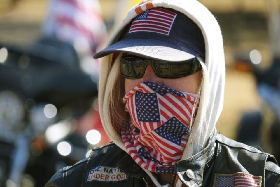 Photo -  A member of the Patriot Guard Riders is masked up at the unveiling of the new Oklahoma Medal of Honor Memorial at Manuel Perez Park in a ceremony on Veterans Day. The Oklahoma City Council will vote this week on extending the city's mask mandate. [Doug Hoke/The Oklahoman]