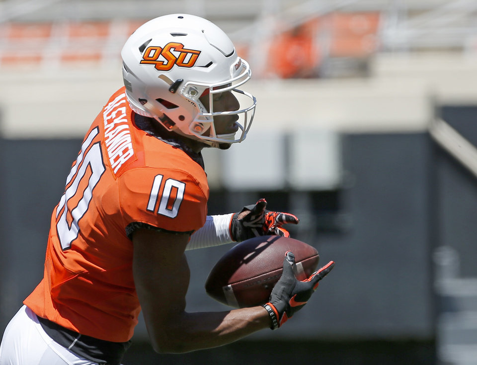 Photo - Oklahoma State's Tyrell Alexander (10) runs after a catch during drills during the Oklahoma State Cowboys spring practice at Boone Pickens Stadium in Stillwater, Okla., Saturday, April 20, 2019.  Photo by Sarah Phipps, The Oklahoman