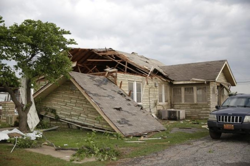 Photo -  Tornado damage to a home along Highway 66 in El Reno, Okla., Sunday, May 26, 2019. [Bryan Terry/The Oklahoman]
