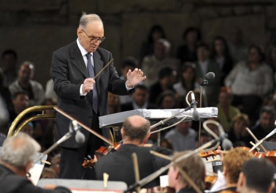Photo -  In this July 12, 2009 file photo, Italian composer Ennio Morricone, conducts with the Budapest Symphonic Orchestra, in southwestern Macedonia. [AP Photo/Boris Grdanoski, file]