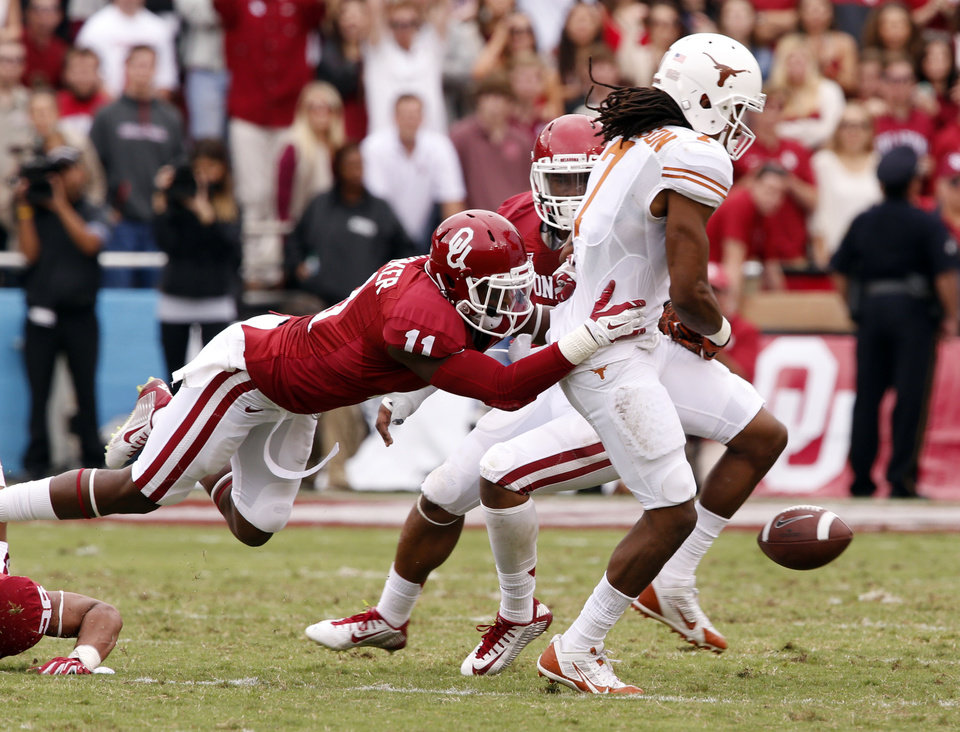Photo - Oklahoma's Steven Parker (11) breaks up a pass to Texas' Marcus Johnson (7) during the second half of the Red River Showdown college football game between the University of Oklahoma Sooners (OU) and the University of Texas Longhorns (UT) at the Cotton Bowl in Dallas, Texas on Saturday, Oct. 11, 2014. 