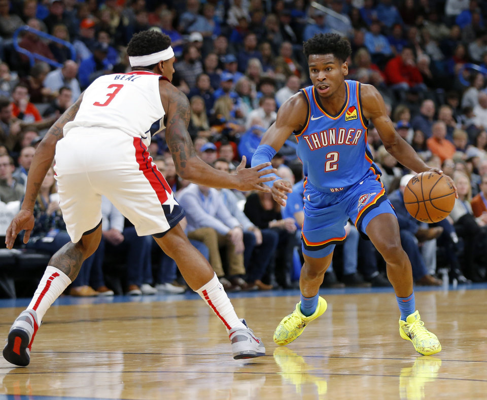 Photo - Oklahoma City's Shai Gilgeous-Alexander (2) drives as Washington's Bradley Beal (3) defends during an NBA basketball game between the Oklahoma City Thunder and the Washington Wizards at Chesapeake Energy Arena in Oklahoma City, Friday, Oct. 25, 2019. [Nate Billings/The Oklahoman]