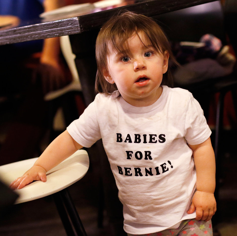 Photo - Claire Kiesel, 1 year old, wears a shirt made especially for her by her parents who brought her and her older brother to the watch party. They were among the nearly 100 enthusiastic supporters of Sen. Bernie Sanders who gathered at the District House in the Plaza District Tuesday, March 1, 2016, to celebrate his projected victory in Oklahoma's Democrat presidential primary election.   Photo by Jim Beckel, The Oklahoman.