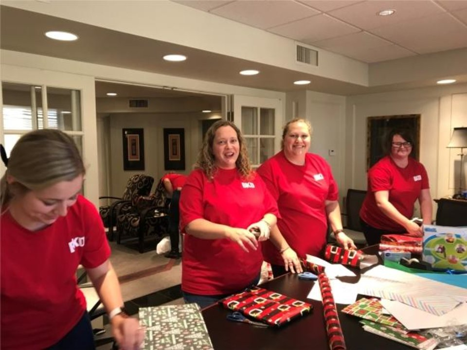 Photo -  Repeat winner BKD CPAs & Advisors claimed the No. 17 spot among midsize employees. Here, Enid employees volunteer for Christmas. [PROVIDED]