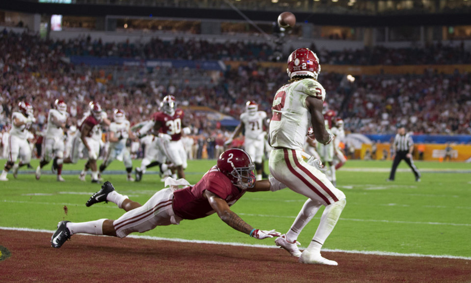Photo - Oklahoma Sooners wide receiver CeeDee Lamb (2) catches a touchdown defended by Alabama Crimson Tide defensive back Patrick Surtain II (2) in the College Football Playoff semifinals in the Orange Bowl at Hard Rock Stadium in Miami Gardens, Florida on December 29, 2018. [ALLEN EYESTONE/palmbeachpost.com]