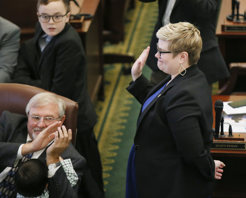 Photo - Rep. Emily Virgin stands and waves after being announced as the new leader of the Democratic caucus near the end of the oath of office ceremony for newly-elected members of the Oklahoma House of Representatives in the House chamber at the state Capitol in Oklahoma City, Nov. 15, 2018. Photo by Nate Billings, The Oklahoman