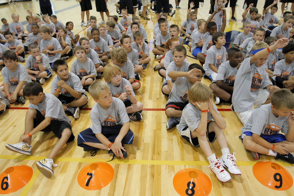 Photo - Children listen to Kevin Durant speak during the second day of the Kevin Durant basketball camp at Heritage Hall in Oklahoma City, Thursday, June 30, 2011.  Photo by Garett Fisbeck, The Oklahoman