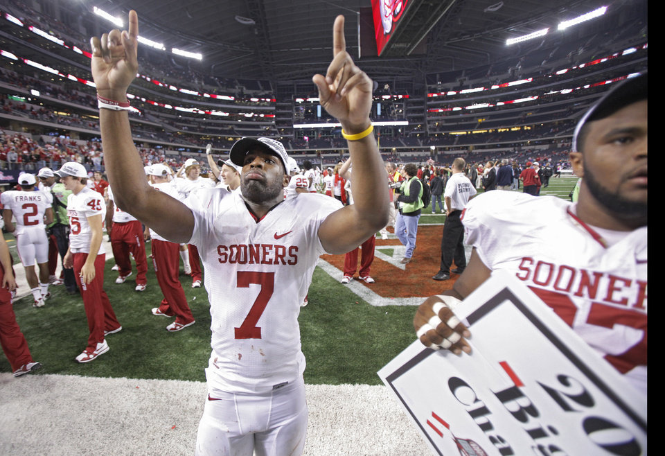 Photo - Oklahoma's DeMarco Murray (7) salutes the fans after the Sooners' 23-20 win over Nebraska during the Big 12 football championship game between the University of Oklahoma Sooners (OU) and the University of Nebraska Cornhuskers (NU) at Cowboys Stadium on Saturday, Dec. 4, 2010, in Arlington, Texas.  Photo by Chris Landsberger, The Oklahoman