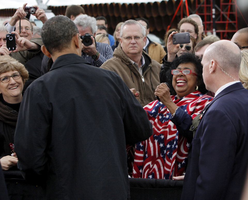 Photo - State Sen. Judy Eason McIntyre of Tulsa, right, reacts after talking with President Barack Obama after he spoke about energy at the TransCanada Pipe Yard near Cushing, Okla., Thursday, March 22, 2012. Photo by Nate Billings, The Oklahoman