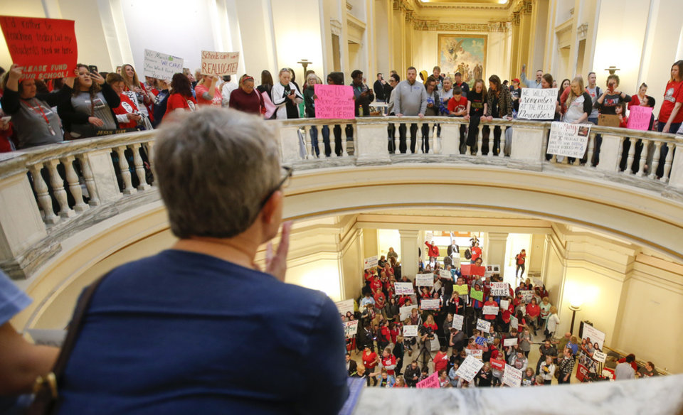 Photo - Teachers and supporters of increased education funding rally on the fourth and second floor rotunda of the state Capitol during the second day of a walkout by Oklahoma teachers, in Oklahoma City, Tuesday, April 3, 2018. Photo by Nate Billings, The Oklahoman