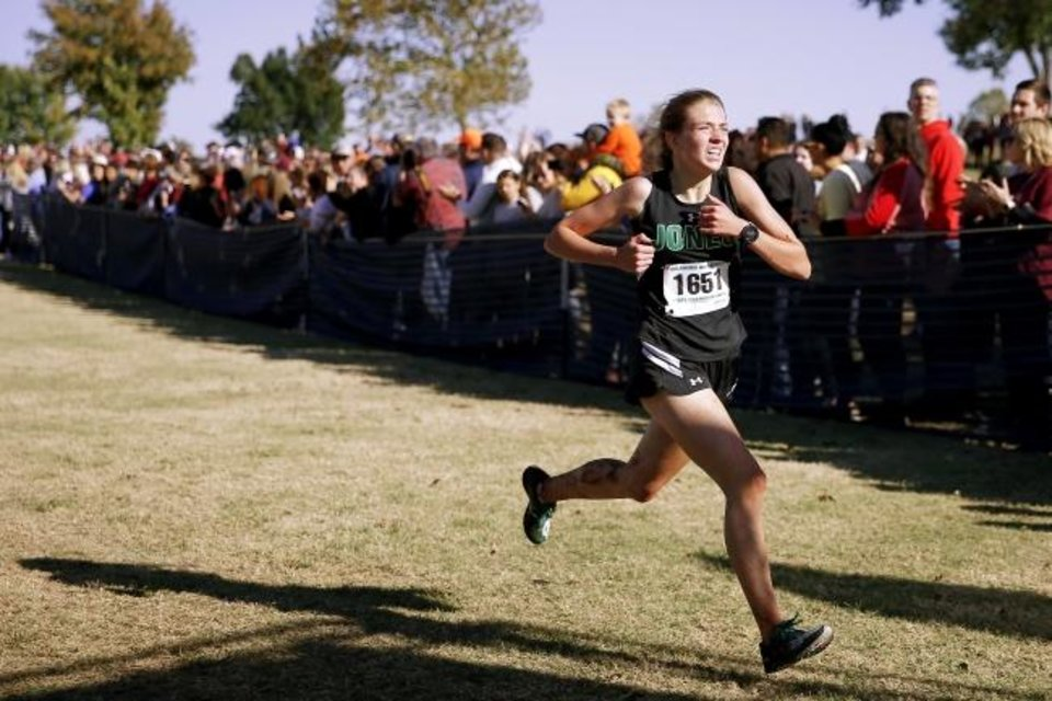 Photo -  Jones freshman Tabitha Fox wins the Class 3A cross country state title Saturday in Shawnee. [Bryan Terry/The Oklahoman]