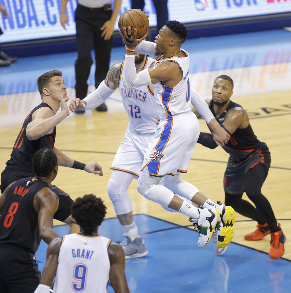 Photo - Oklahoma City's Russell Westbrook (0) goes to the basket beside Portland's Damian Lillard (0)  and Meyers Leonard (11) during Game 4 in the first round of the NBA playoffs between the Portland Trail Blazers and the Oklahoma City Thunder at Chesapeake Energy Arena in Oklahoma City, Sunday, April 21, 2019. Photo by Bryan Terry, The Oklahoman