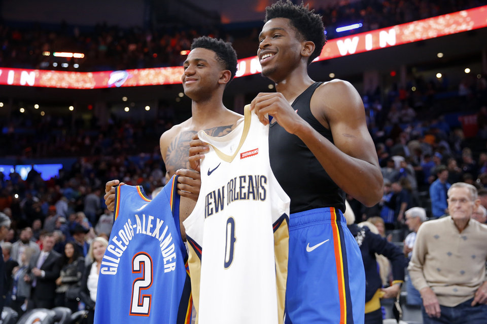 Photo - Oklahoma City's Shai Gilgeous-Alexander, right, poses for a photo after swapping jerseys with Nickeil Alexander-Walker of the Pelicans after an NBA basketball game between the Oklahoma City Thunder and the New Orleans Pelicans at Chesapeake Energy Arena in Oklahoma City, Saturday, Nov. 2, 2019. Oklahoma City won 115-104. [Bryan Terry/The Oklahoman]