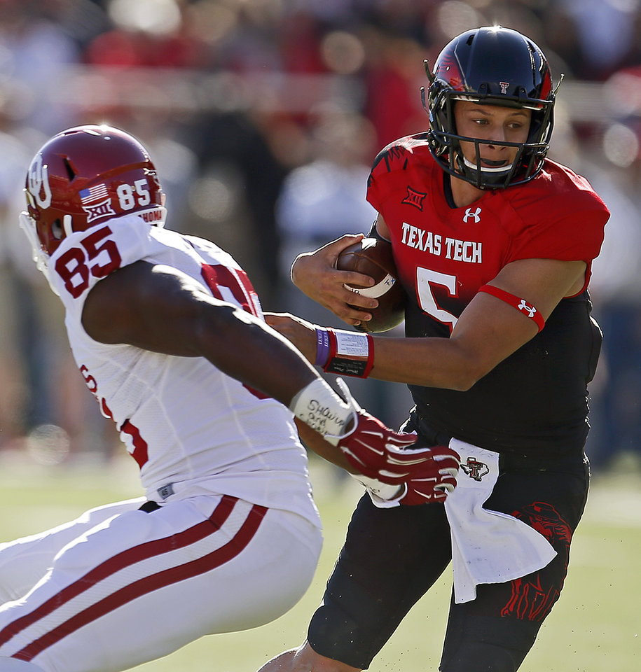 Photo - Patrick Mahomes (5) runs past Oklahoma's Geneo Grissom (85) during a college football game between the University of Oklahoma Sooners (OU) and the Texas Tech Red Raiders at Jones AT&T Stadium in Lubbock, Texas, Saturday, November 15, 2014.  Photo by Bryan Terry, The Oklahoman